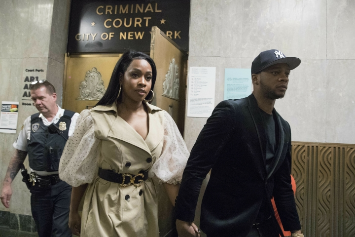 Rapper Remy Ma, left, leaves Manhattan Criminal Court with her husband, rapper Papoose, after her arraignment on an assault charge, Wednesday, May 1, 2019, in New York. Remy Ma has been arrested on assault charges for allegedly attacking a reality television personality in New York City last month. (AP Photo/Mary Altaffer)