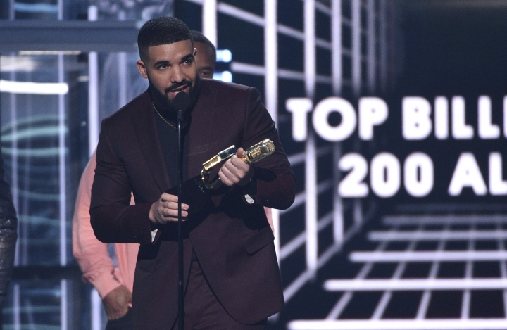 "Drake accepts the top billboard 200 album award for ""Scorpion"" at the Billboard Music Awards on Wednesday, May 1, 2019, at the MGM Grand Garden Arena in Las Vegas. (Photo by Chris Pizzello/Invision/AP)"