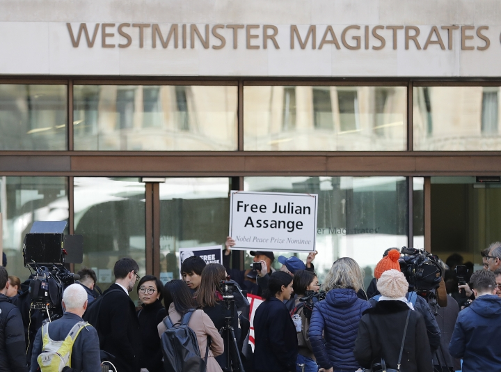 Media and supporters wait at the entrance of Westminster Magistrates Court in London, Thursday, May 2, 2019, where WikiLeaks founder Julian Assange is expected to appear by video link from prison. Assange is facing a court hearing over a U.S. request to extradite him for alleged computer hacking.(AP Photo/Frank Augstein)