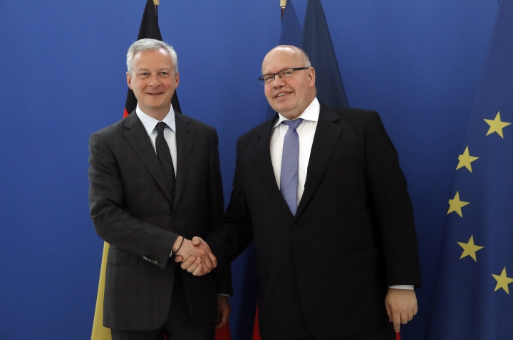 French Economy and Finance Minister Bruno Le Maire, left, and his German counterpart Peter Altmaier pose before a meeting in Paris, Thursday, May 2, 2019. France and Germany unveiled details of a plan to create a leading electric battery industry in Europe, from extraction of raw materials to recycling.(AP Photo/Christophe Ena)