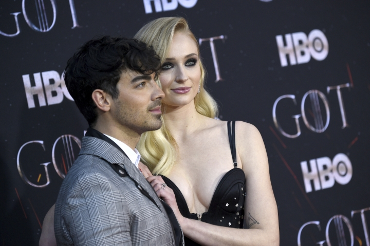 "FILE - In this April 3, 2019 file photo, Joe Jonas, left, and Sophie Turner attend HBO's ""Game of Thrones"" final season premiere at Radio City Music Hall in New York. The couple have gotten married in a surprise ceremony in Las Vegas. It happened Wednesday night, May 1 after the Billboard Music Awards, where the Jonas Brothers had performed. Turner's publicist confirmed the nuptials, which DJ Diplo posted on his Instagram live feed. (Photo by Evan Agostini/Invision/AP, File)"