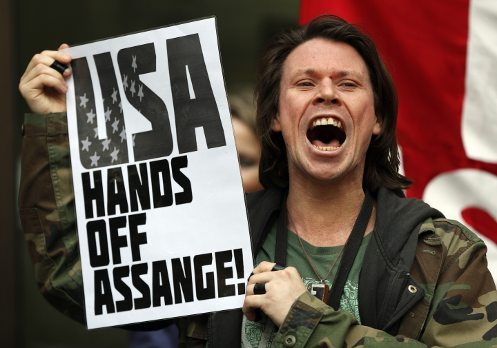 British activist Lauri Love protests at the entrance of Westminster Magistrates Court in London, Thursday, May 2, 2019. WikiLeaks founder Julian Assange is facing a court hearing over a U.S. request to extradite him for allegedly conspiring to hack a Pentagon computer. Assange is expected to appear by video link from prison for the hearing at London's Westminster Magistrates' Court. (AP Photo/Frank Augstein)