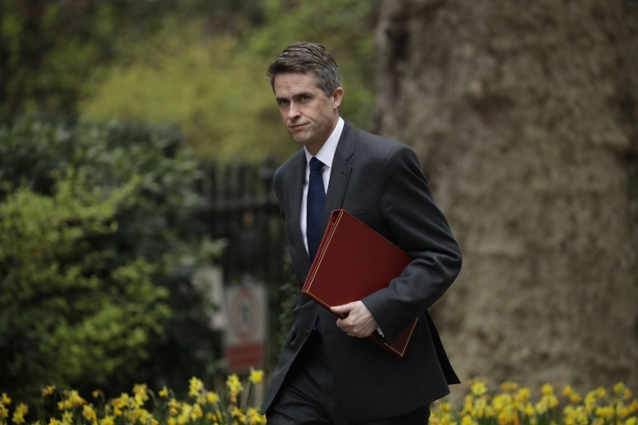 "FILE - In this Tuesday, April 2, 2019 file photo, Britain's Defence Secretary Gavin Williamson arrives for a cabinet meeting in 10 Downing Street, London. British Defense Secretary Gavin Williamson has been fired Wednesday, May 1 after an investigation into leaks from a secret government meeting about Chinese telecoms firm Huawei. Prime Minister Theresa May's office says May has ""lost confidence"" in Williamson. (AP Photo/Matt Dunham)"