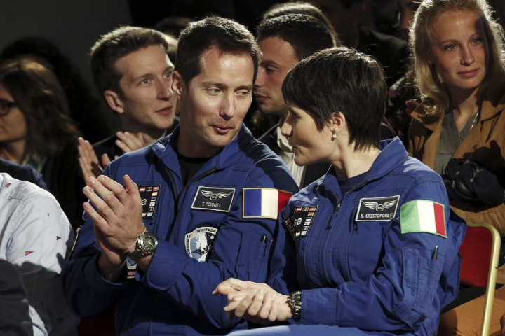 French astronaut Thomas Pesquet, left, and Italian astronaut Samantha Cristoforetti, right, attend an event to commemorate the 500th anniversary of the death of Italian Renaissance painter and scientist Leonardo da Vinci at the Chambord Castle, in Chambord, France, Wednesday, May 2, 2019. (Yoan Valat, Pool via AP)