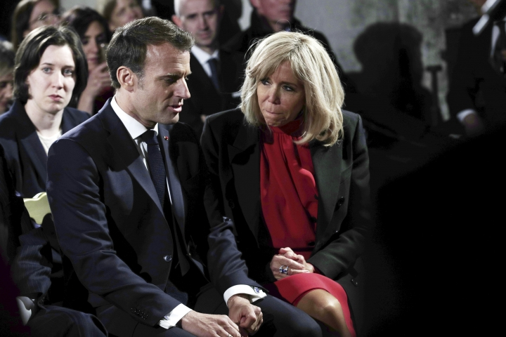 French President Emmanuel Macron, left, and his wife Brigitte Macron, left, with Italian President Sergio Mattarella and his daughter Laura Mattarella attend an event to commemorate the 500th anniversary of the death of Italian Renaissance painter and scientist Leonardo da Vinci, at the Chambord Castle, in Chambord, France, Wednesday, May 2, 2019. (Yoan Valat, Pool via AP)