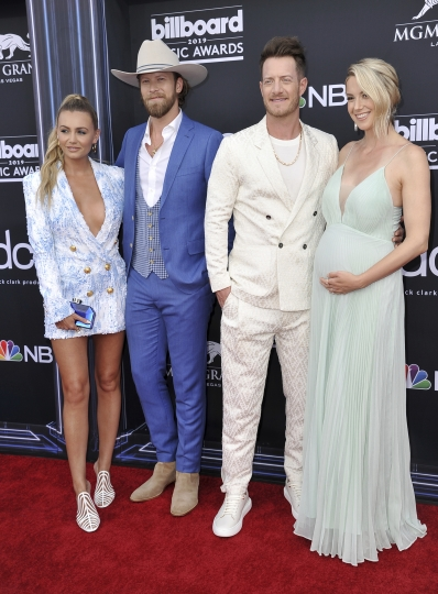 Brittney Marie Cole, from left, Brian Kelley and Tyler Hubbard, of Florida Georgia Line, and Hayley Stommel arrive at the Billboard Music Awards on Wednesday, May 1, 2019, at the MGM Grand Garden Arena in Las Vegas. (Photo by Richard Shotwell/Invision/AP)