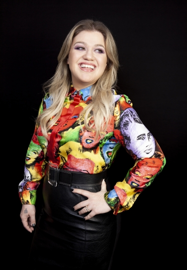 "This April 14, 2019 photo shows singer and actress Kelly Clarkson posing for a portrait at the Four Seasons Hotel in Los Angeles to promote her animated film ""Uglydolls."" (Photo by Rebecca Cabage/Invision/AP)"