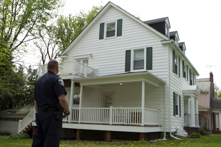 Baltimore police officer stand outside the house of Baltimore Mayor Catherine Pugh in Baltimore, MD., Thursday, April 25, 2019. Agents with the FBI and IRS are gathering evidence inside the two homes of Pugh and also in City Hall. (AP Photo/Jose Luis Magana)