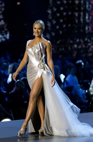 FILE - In this Dec. 13, 2018, file photo, Miss USA Sarah Rose Summers participates in the swimsuit and evening gown stage of the 67th Miss Universe competition in Bangkok, Thailand. The women who want to be crowned the next Miss USA include a psychological operations expert in the Army reserves, a former NFL cheerleader on a career path to become a surgical nurse and a lawyer who represents unjustly jailed prisoners for free. The 51 contestants representing each U.S. state and the District of Columbia take the stage Thursday, May 2, 2019, in Reno, Nev., for the first time at a hotel-casino where Vanessa and Nick Lachey will serve as hosts. (AP Photo/Gemunu Amarasinghe, File)