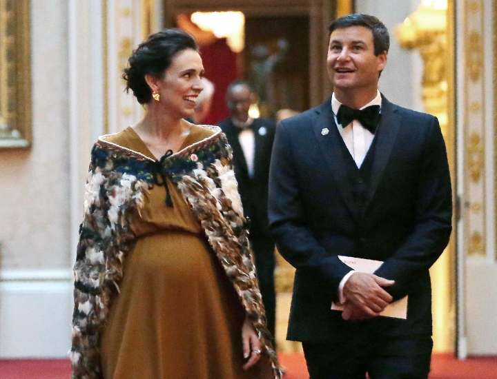 FILE - In this April 19, 2018, file photo, New Zealand's Prime Minister Jacinda Ardern and her partner Clarke Gayford arrive in the East Gallery at Buckingham Palace in London as Queen Elizabeth II hosts a dinner during the Commonwealth Heads of Government Meeting (CHOGM). A spokesman for Ardern said on Friday, May 3, 2019, the pair got engaged over the Easter break in the town of Mahia but said any further details would be for Ardern to discuss when she next speaks to media on Monday. (Daniel Leal-Olivas/Pool via AP, File)