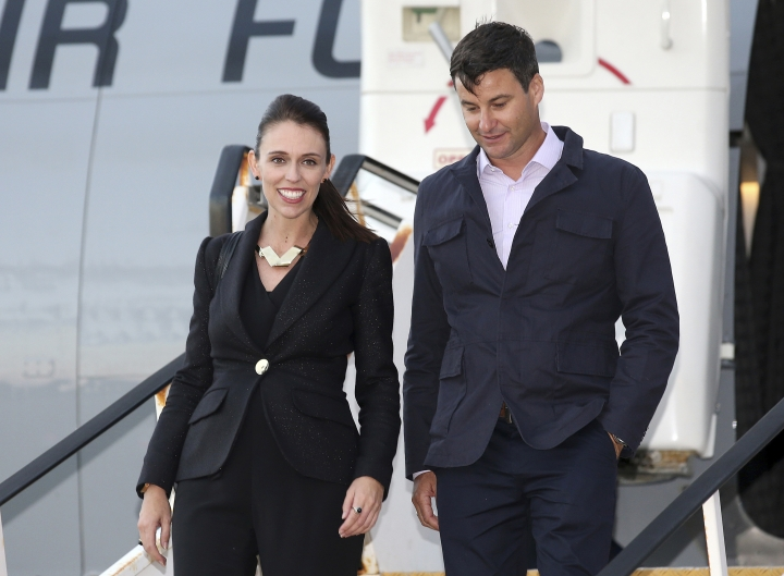 FILE - In this March 1, 2018, file photo, New Zealand Prime Minister Jacinda Ardern, left, and her partner Clarke Gayford arrive in Sydney. A spokesman for Ardern said on Friday, May 3, 2019, the pair got engaged over the Easter break in the town of Mahia but said any further details would be for Ardern to discuss when she next speaks to media on Monday. (AP Photo/Rick Rycroft, File)