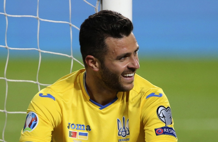 FILE - In this Friday, March 22, 2019 file photo, Ukraine's Junior Moraes sits on the pitch after missing a scoring chance during the Euro 2020 group B qualifying soccer match between Portugal and Ukraine at the Luz stadium in Lisbon. UEFA has dismissed protests by defending champion Portugal and Luxembourg about Ukraine fielding Brazil-born forward Junior Moraes in European Championship qualifying games. (AP Photo/Armando Franca, File)