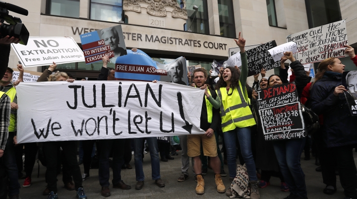 Protestors demonstrate at the entrance of Westminster Magistrates Court in London, Thursday, May 2, 2019. WikiLeaks founder Julian Assange is facing a court hearing over a U.S. request to extradite him for allegedly conspiring to hack a Pentagon computer. Assange is expected to appear by video link from prison for the hearing at London's Westminster Magistrates' Court. (AP Photo/Frank Augstein)