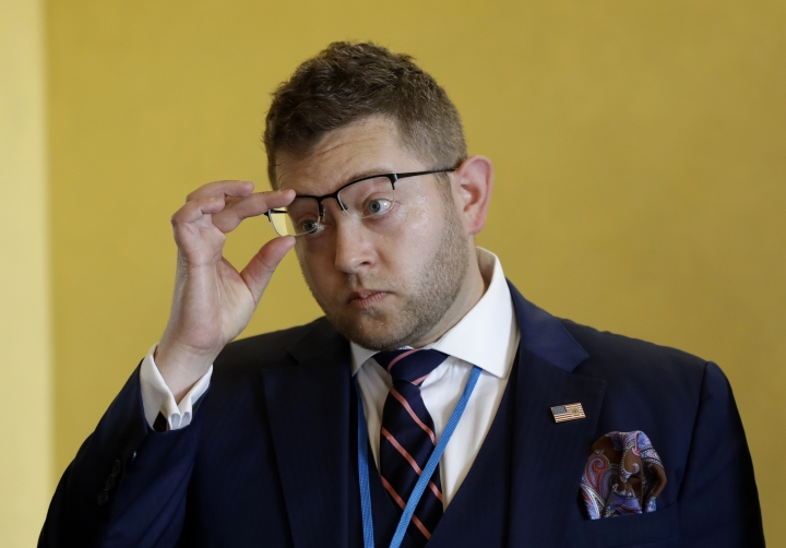 Joshua Steinman, an advisor to US President Donald Trump on cyber issues, adjusts his glasses prior the start of The Prague 5G Security Conference in Prague, Czech Republic, Thursday, May 2, 2019. (AP Photo/Petr David Josek)