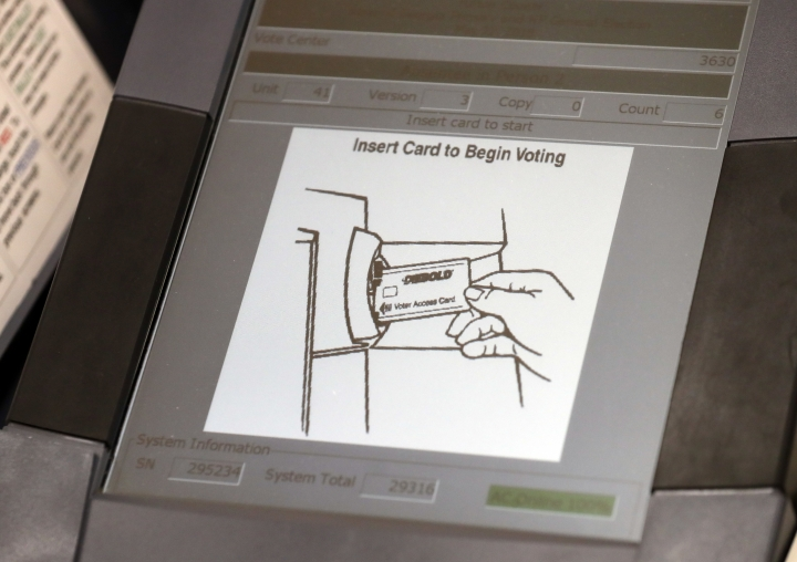 FILE - This May 9, 2018, photo shows a touch screen of a voting machine during early voting in Sandy Springs, Ga. Whether campaigns have learned from the cyberattacks in the 2016 election is a critical question ahead of next year's presidential race. (AP Photo/John Bazemore)