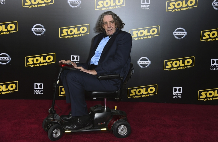 "RETRANSMISSION TO CORRECT DAY AND DATE OF DEATH - FILE - This May 10, 2018 file photo shows Peter Mayhew at the premiere of ""Solo: A Star Wars Story"" in Los Angeles. Mayhew, who played the rugged, beloved and furry Wookiee Chewbacca in the ""Star Wars"" films, has died. Mayhew died at his home in north Texas on Tuesday, April 30, 2019 according to a family statement. He was 74. No cause was given. (Photo by Jordan Strauss/Invision/AP, File)"
