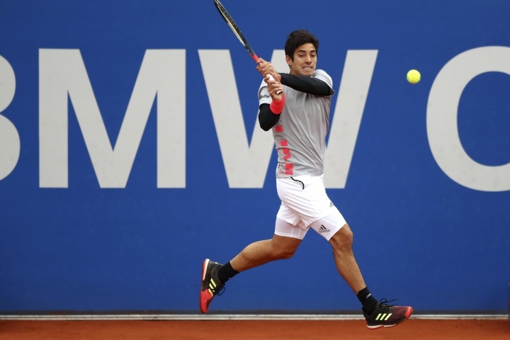 Cristian Garin of Chile returns the ball during his quarterfinal match against Alexander Zverev of Germany at the ATP tennis tournament in Munich, Germany, Friday, May 3, 2019. (AP Photo/Matthias Schrader)