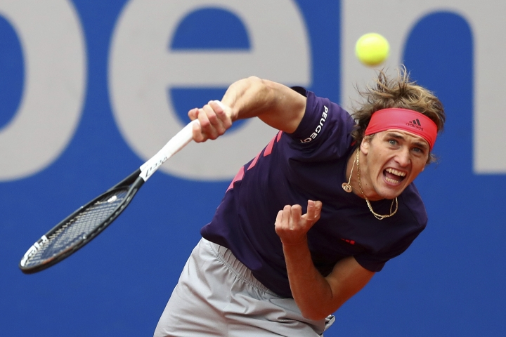 Alexander Zverev of Germany serves the ball to Cristian Garin of Chile during his quarterfinal match at the ATP tennis tournament in Munich, Germany, Friday, May 3, 2019. (AP Photo/Matthias Schrader)