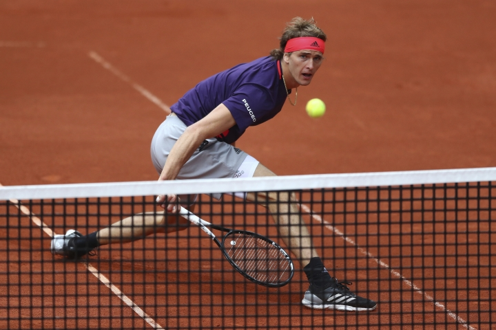 Alexander Zverev of Germany returns the ball to Cristian Garin of Chile during his quarterfinal match at the ATP tennis tournament in Munich, Germany, Friday, May 3, 2019. (AP Photo/Matthias Schrader)