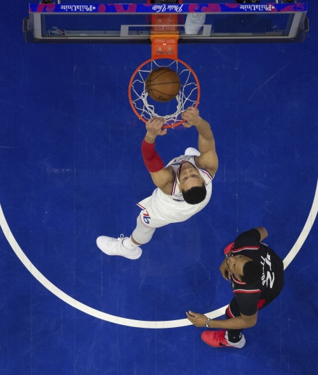 Philadelphia 76ers' Ben Simmons dunks as Toronto Raptors' Norman Powell, right, watches during the first half of Game 3 of a second-round NBA basketball playoff series Thursday, May 2, 2019, in Philadelphia. The 76ers won 116-95. (AP Photo/Chris Szagola)