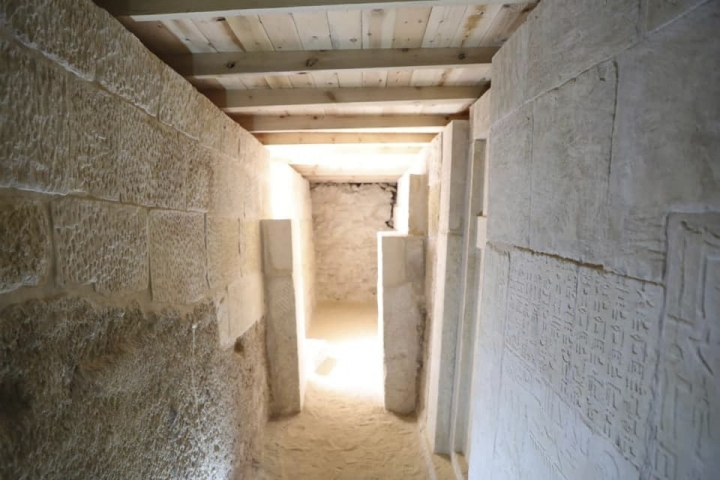 This photo provided by Ministry of Antiquities shows an uncovered part of ancient cemetery at an area by the famed pyramids at the Giza plateau just outside Cairo, Egypt, Saturday, May 4, 2019. Mostafa Waziri, secretary general of the Supreme Council of Antiquities, says Saturday the cemetery houses burial shafts and tombs of top officials and a fine limestone statue from the Old Kingdom's Fifth Dynasty (2465-2323 B.C.). (Ministry of Antiquities via AP)