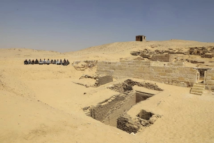 This photo provided by Ministry of Antiquities shows an ancient cemetery at an area by the famed pyramids at the Giza plateau just outside Cairo, Egypt, Saturday, May 4, 2019. Mostafa Waziri, secretary general of the Supreme Council of Antiquities, says Saturday the cemetery houses burial shafts and tombs of top officials and a fine limestone statue from the Old Kingdom's Fifth Dynasty (2465-2323 B.C.). (Ministry of Antiquities via AP)