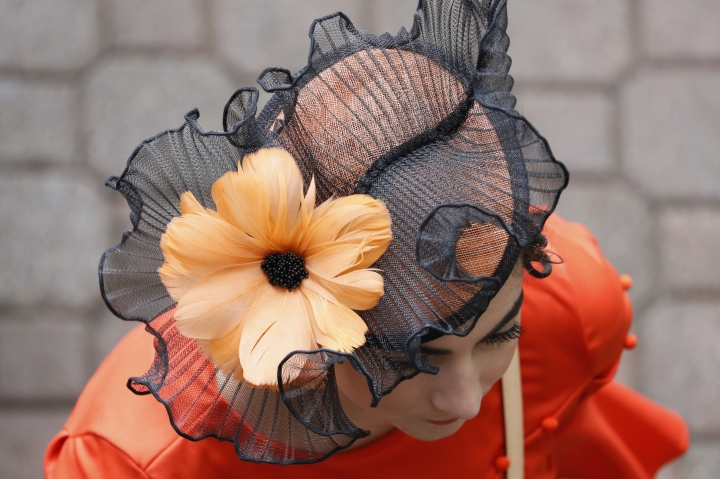 A woman wears a hat before the 145th running of the Kentucky Derby horse race at Churchill Downs Saturday, May 4, 2019, in Louisville, Ky. (AP Photo/John Minchillo)