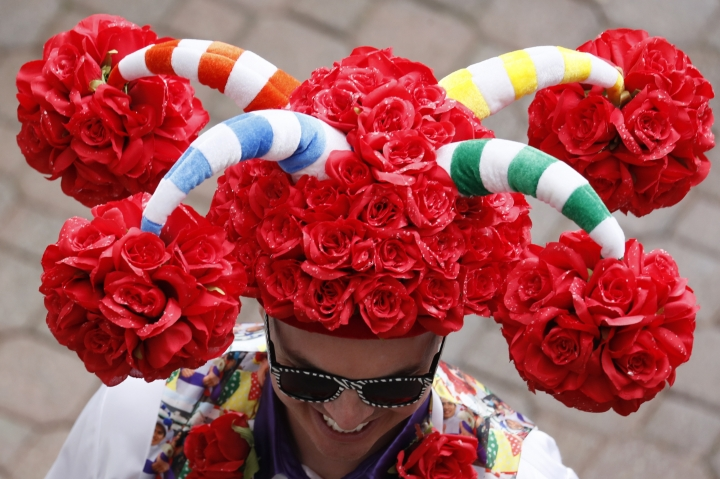 A man wears a hat before the 145th running of the Kentucky Derby horse race at Churchill Downs Saturday, May 4, 2019, in Louisville, Ky. (AP Photo/John Minchillo)