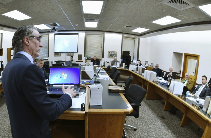 FILE - In this Jan. 9, 2019, file photo, North Dakota Gov. Doug Burgum, left, answers question from members of the House Appropriations Committee's Education and Environment Division in Bismarck, N.D., on funding of the proposed Theodore Roosevelt Presidential Library Museum in the small town of Medora. An heir to the Wal-Mart fortune, a wealthy governor and energy companies operating in the North Dakota oil patch could fund a big chunk of the private money needed by developers of a presidential library for Theodore Roosevelt in the western Badlands. (Mike Mccleary/The Bismarck Tribune via AP, File)