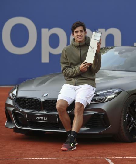 Cristian Garin of Chile holds the trophy of the ATP tennis tournament after defeating Italy's Matteo Berrettini in the final match, in Munich, Germany, Sunday, May 5, 2019. (AP Photo/Matthias Schrader)
