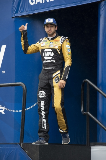 Chase Elliott gives a thumbs-up during driver introductions at a NASCAR Cup Series auto race Sunday, May 5, 2019, at Dover International Speedway in Dover, Del. (AP Photo/Jason Minto)