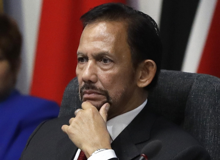 "FILE - In this April 19, 2018, file photo, the Sultan of Brunei Hassanal Bolkiah listens during the first executive session of the CHOGM summit at Lancaster House in London. Brunei's sultan has said a moratorium on capital punishment is in effect for new Shariah criminal laws including stoning people for gay sex and adultery that sparked an international outcry. Sultan Hassanal Bolkiah said Sunday, May 5, in a speech to mark the start of Ramadan that he was aware of the ""many questions and misperceptions"" over the penalties provided for under new sections of Brunei's Shariah Penal Code, but stressed that there should be no fear.(AP Photo/Kirsty Wigglesworth, File)"