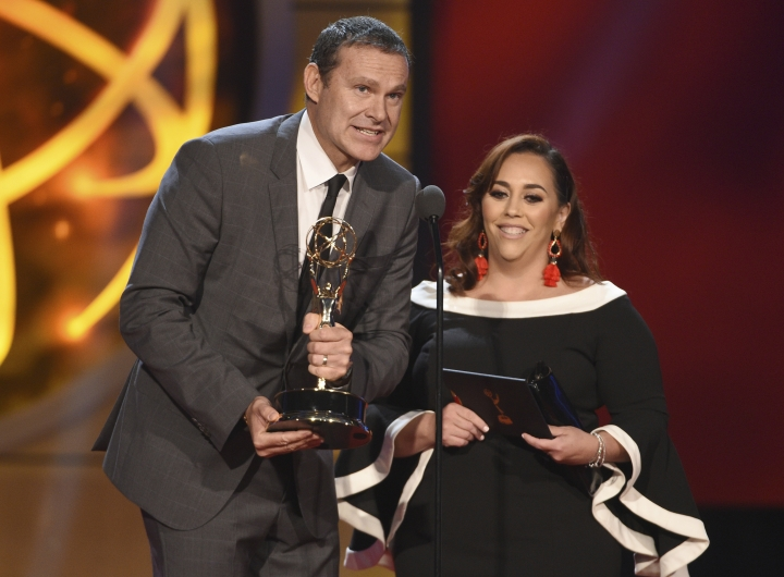 "Alan Tacher, left, and Glicia Marquez-Pronesti accept the award for outstanding morning program in Spanish for ""Despierta America"" at the 46th annual Daytime Emmy Awards at the Pasadena Civic Center on Sunday, May 5, 2019, in Pasadena, Calif. (Photo by Chris Pizzello/Invision/AP)"