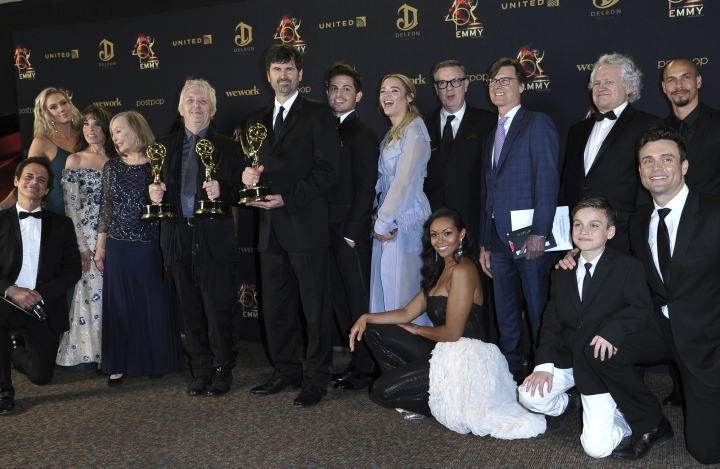 "The cast and crew of ""The Young and the Restless"" pose in the press room with the award for outstanding drama series at the 46th annual Daytime Emmy Awards at the Pasadena Civic Center on Sunday, May 5, 2019, in Pasadena, Calif. (Photo by Richard Shotwell/Invision/AP)"
