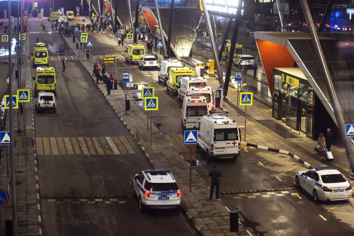 Emergency service vehicles are parked at the entrance of Sheremetyevo airport in Moscow, Russia, Sunday, May 5, 2019. Russia's flagship airline Aeroflot says the plane that caught fire at Moscow's Sheremetyevo Airport, killing at least one person, had been forced to turn back after taking off for the city of Murmansk because of technical reasons. (AP Photo/Alexander Zemlianichenko)