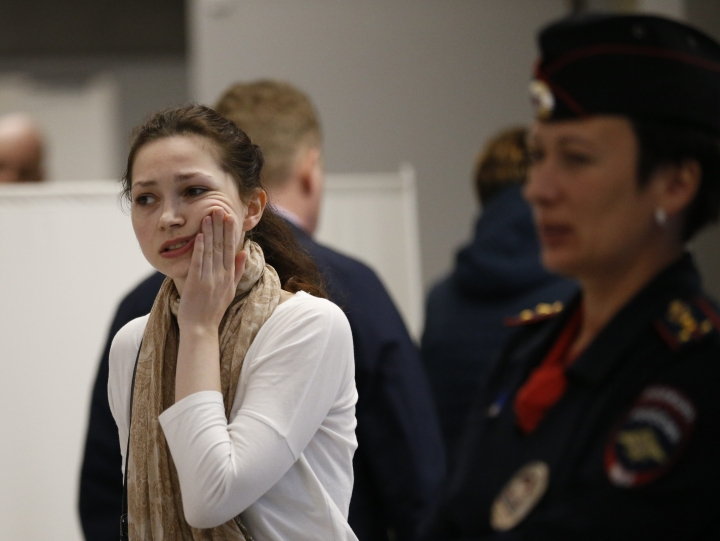 A relative of a victim reacts as she leaves a place where others are gathered at the Sheremetyevo airport in Moscow, Russia, Sunday, May 5, 2019. At least 40 people died when an Aeroflot airliner burst into flames while making an emergency landing at Moscow's Sheremetyevo airport, officials said early Monday. (AP Photo/Alexander Zemlianichenko)
