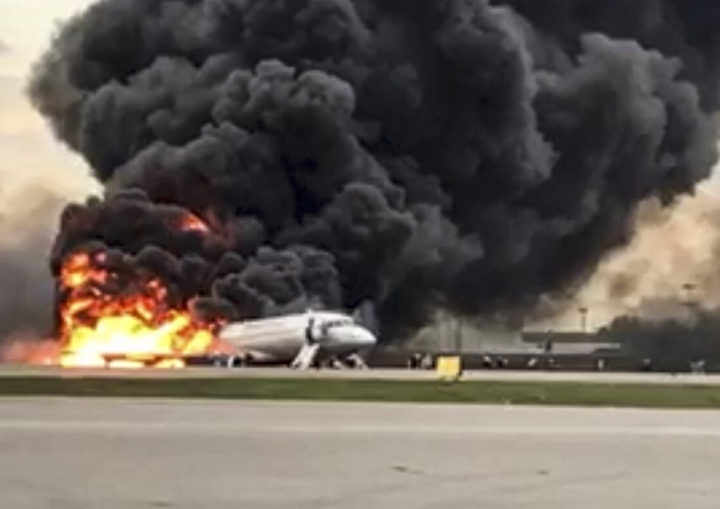 This image taken from a video distributed by Russian Investigative Committee on Sunday, May 5, 2019, shows the Sukhoi SSJ100 aircraft of Aeroflot Airlines on fire, at Sheremetyevo airport, outside Moscow, Russia. At least 40 people died when an Aeroflot airliner burst into flames while making an emergency landing at Moscow's Sheremetyevo airport, officials said early Monday. (The Investigative Committee of the Russian Federation via AP)
