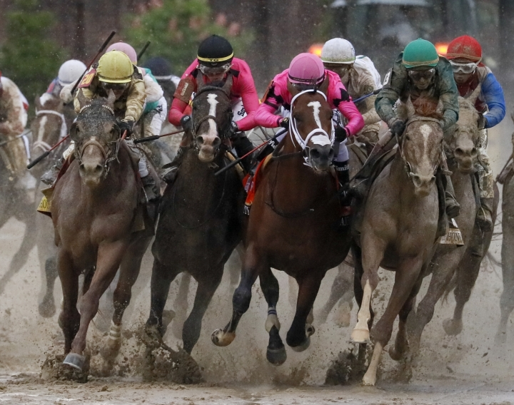 Luis Saez riding Maximum Security, second from right, goes around turn four with Flavien Prat riding Country House, left, Tyler Gaffalione riding War of Will and John Velazquez riding Code of Honor, right, during the 145th running of the Kentucky Derby horse race at Churchill Downs Saturday, May 4, 2019, in Louisville, Ky. (AP Photo/John Minchillo)