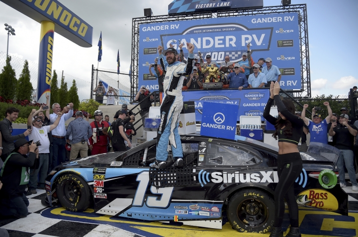 Driver Martin Truex Jr. (19) celebrates in victory lane after winning the NASCAR Cup Series auto race, Monday, May 6, 2019, at Dover International Speedway in Dover, Del. (AP Photo/Will Newton)