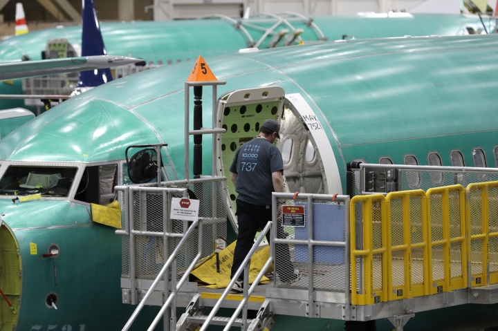 FILE - This March 27, 2019, file photo shows a Boeing 737 MAX 8 airplane on the assembly line during a brief media tour of Boeing's 737 assembly facility in Renton, Wash. Recent crashes have caused an uptick in airline fatalities in 2018 and 2019 after a long trend of safer flying. Boeing 737 Max accidents have raised concern over the ability of all pilots to handle automation. Still, aviation deaths are down sharply from the 1990s, and experts credit advances in aircraft and airport design, better air traffic control, and more pilot training. (AP Photo/Ted S. Warren, File)