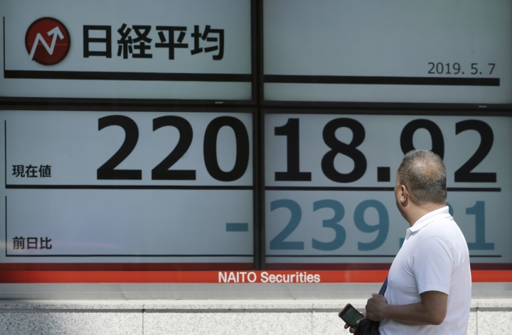 A man looks at an electronic stock board showing Japan's Nikkei 225 index at a securities firm in Tokyo Tuesday, May 7, 2019. Asian stock markets rebounded Tuesday after Beijing said trade negotiators were preparing to go to Washington despite President Donald Trump's threat to escalate their tariff war. (AP Photo/Eugene Hoshiko)