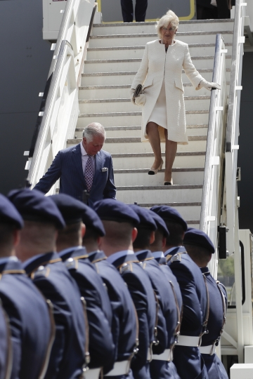 Camilla, Duchess of Cornwall, on the stairs right, and Britain's Prince Charles, on the stairs left, the Prince of Wales leave the plane after they arrive for a four days visit in Germany, at the airport Tegel in Berlin, Tuesday, May 7, 2019. (AP Photo/Markus Schreiber, Pool)