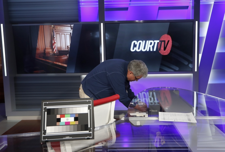 In this Thursday, May 2, 2019, photo, audio technician Rick Perry works on the Court TV anchor desk, in Atlanta. The channel for legal junkies that thrived during the trial-crazy 1990s comes back from the dead after more than a decade, on Wednesday, May 8, 2019, amid a true-crime craze that its backers hope will launch it into a long new life. (AP Photo/John Bazemore)