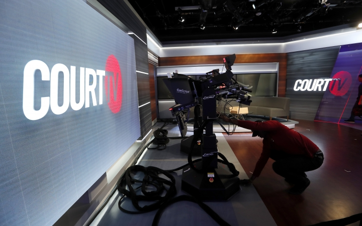 In this Thursday, May 2, 2019, photo, a camera operator works on the set of the Court TV anchor desk, in Atlanta. The channel for legal junkies that thrived during the trial-crazy 1990s comes back from the dead after more than a decade, on Wednesday, May 8, 2019, amid a true-crime craze that its backers hope will launch it into a long new life. (AP Photo/John Bazemore)