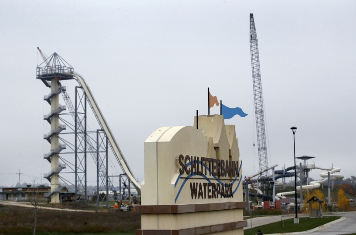FILE - In this Oct. 30, 2018, file photo, crews dismantle the Verruckt waterslide at the Schlitterbahn water park in Kansas City, Kan. The Kansas water park where 10-year-Caleb Schwab was decapitated isn't hiring lifeguards, advertising or selling tickets with less than a month left before its typical Memorial Day weekend opening date. Schlitterbahn remains mum on its plans, but has largely removed reference from its website about the Kansas City, Kansas, park. Schwab was killed in 2016 when the raft he was riding on the 17-story Verruckt slide went airborne and hit a metal pole. (AP Photo/Charlie Riedel, File)