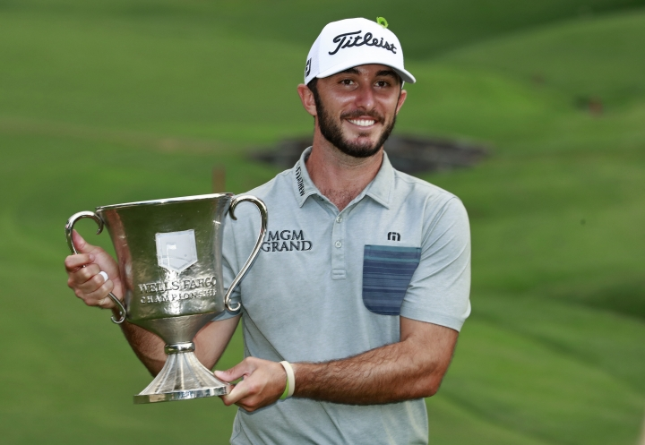 Max Homa poses with the trophy after winning the Wells Fargo Championship golf tournament at Quail Hollow Club in Charlotte, N.C., Sunday, May 5, 2019. (AP Photo/Jason E. Miczek)