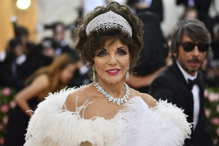 "Joan Collins attends The Metropolitan Museum of Art's Costume Institute benefit gala celebrating the opening of the ""Camp: Notes on Fashion"" exhibition on Monday, May 6, 2019, in New York. (Photo by Charles Sykes/Invision/AP)"