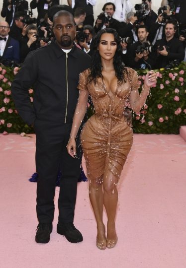 "Kanye West, left, and Kim Kardashian attend The Metropolitan Museum of Art's Costume Institute benefit gala celebrating the opening of the ""Camp: Notes on Fashion"" exhibition on Monday, May 6, 2019, in New York. (Photo by Charles Sykes/Invision/AP)"