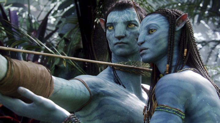"FILE - This image released by 20th Century Fox shows the characters Neytiri, right, and Jake in a scene from the 2009 movie ""Avatar."" The Walt Disney Co. on Tuesday laid out its plans for upcoming 20th Century Fox films. James Cameron's long-delayed ""Avatar 2"" will now open in theaters in December 2021 instead of its most recent date of December 2020. The two subsequent ""Avatar"" sequels will move to 2023 and 2025, respectively. (AP Photo/20th Century Fox, File)"