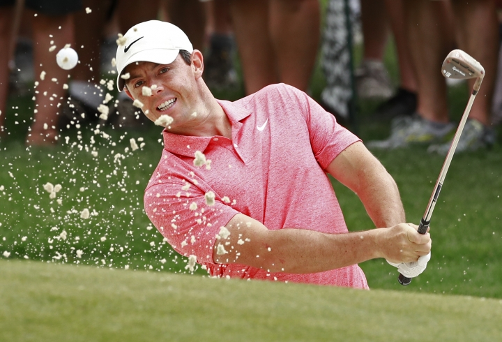 Rory McIlroy, of Northern Ireland, hits from a sand trap on the first hole during the final round of the Wells Fargo Championship golf tournament at Quail Hollow Club in Charlotte, N.C., Sunday, May 5, 2019. (AP Photo/Jason E. Miczek)